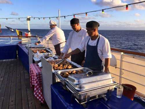 RMS chefs preparing a barbecue [Saint Helena Island Info:Fishing]