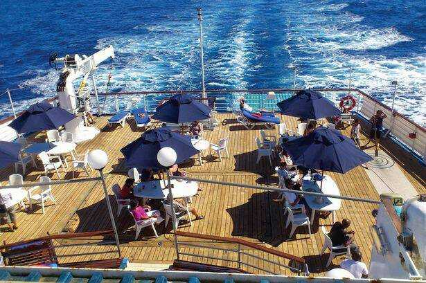 History: Catching some sun on deck [Saint Helena Island Info:Read articles about St Helena (Older)]