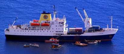 RMS St Helena with attendant boats