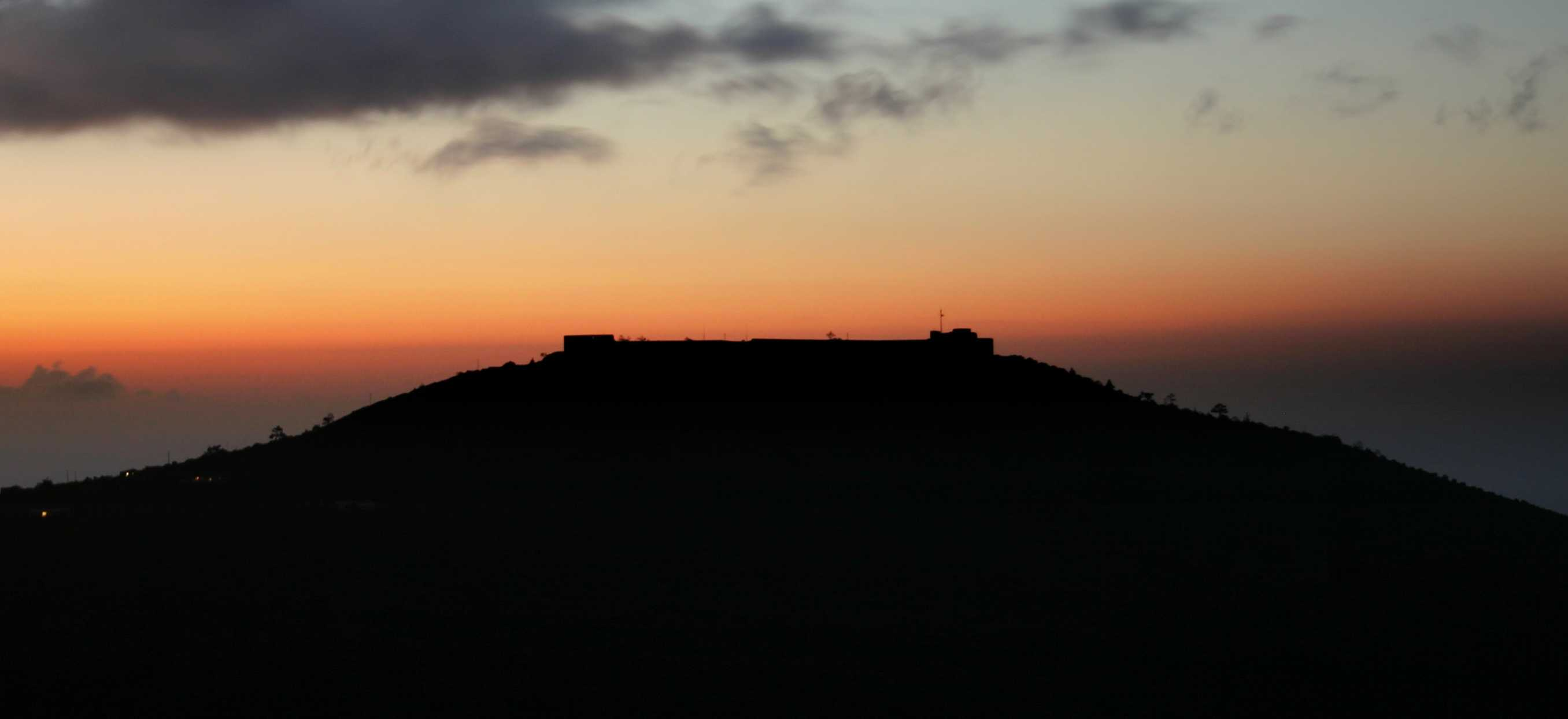 Sunset, silhouetting High Knoll Fort