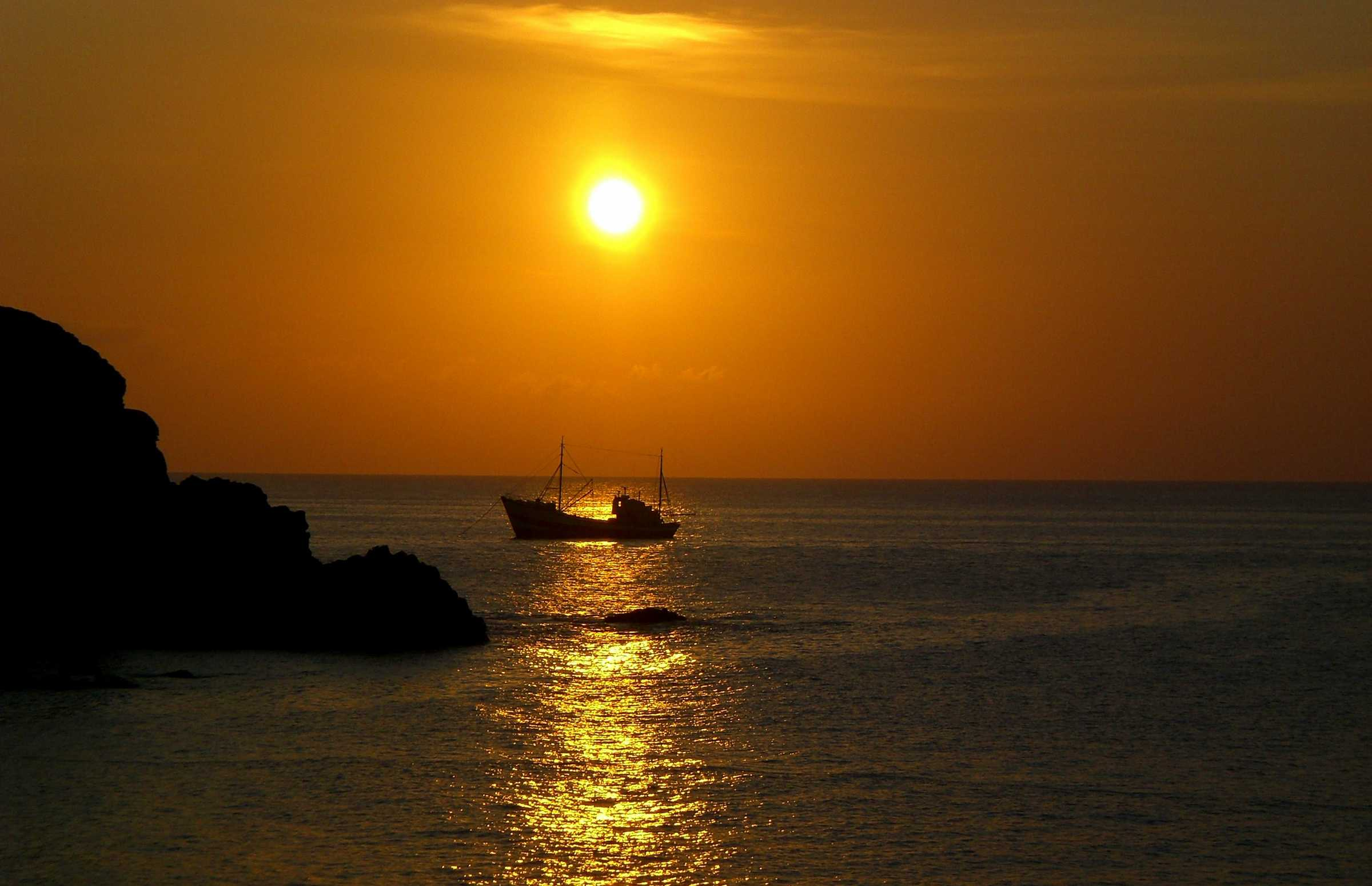 Sunset with fishing vessel Portzic [Saint Helena Island Info:Fishing]