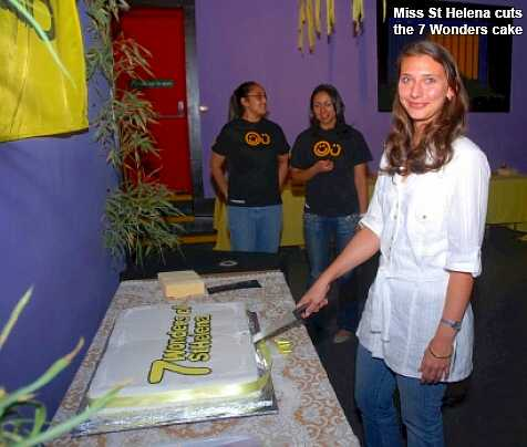 Miss St Helena cuts the Seven Wonders cake